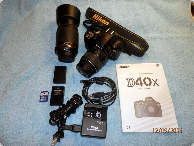 Nikon D40X Camera with 18-55mm lens, 55-200mm lens, 2 batteries, battery charger, USB cable, 4GB SDHC memory card, neck strap and instruction Manual.
