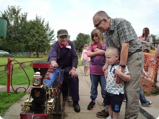 Olivia aged 8 - Luke 4 and Uncle Mark inspect the locomotive after their ride