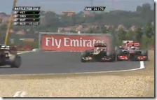 Grosjean supera Button tagliando al chicane