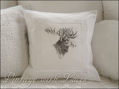 White pillow with moose graphic