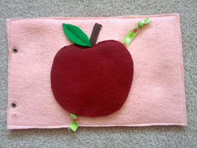 Apple & worm quiet book page from And Next Comes L