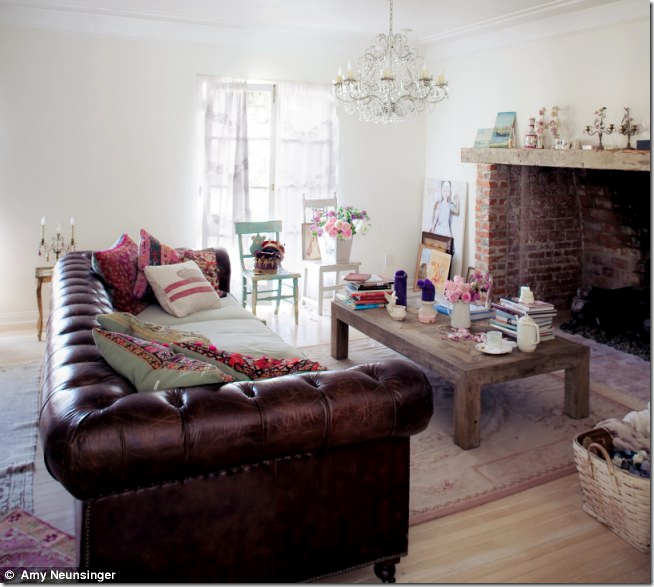 inside the living room there is a surprising brown leather chesterfield sofa and a wonderful crystal chandelier the sofa is sold on her web site chesterfield furniture history