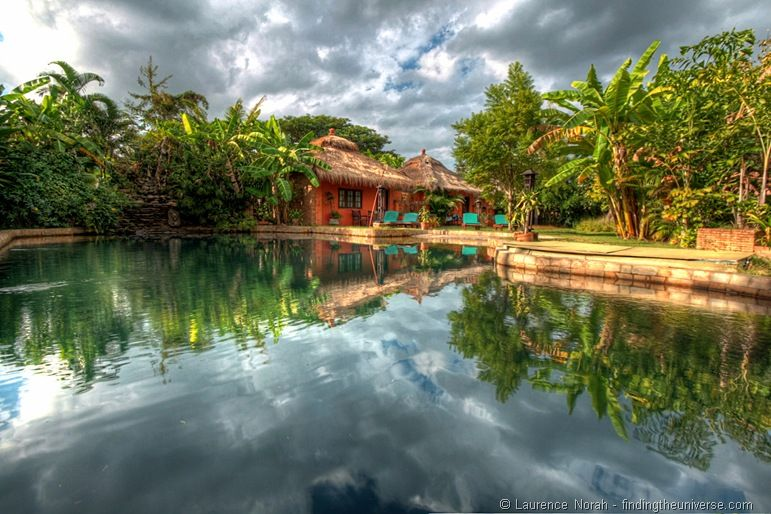 Reflection of chalet pool banana trees hostel by Laurence of findingtheuniverse.com