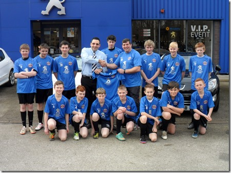 General manager of Gateway Crewe, Alex Walker, with the Cheshire Blades under 14s squad and team manager Simon Richards