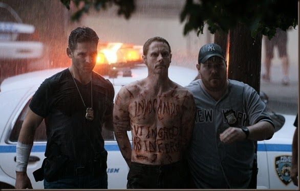 Sarchie (Eric Bana) brings in Santino (Sean Harris) with other officers in Screen Gems' DELIVER US FROM EVIL.