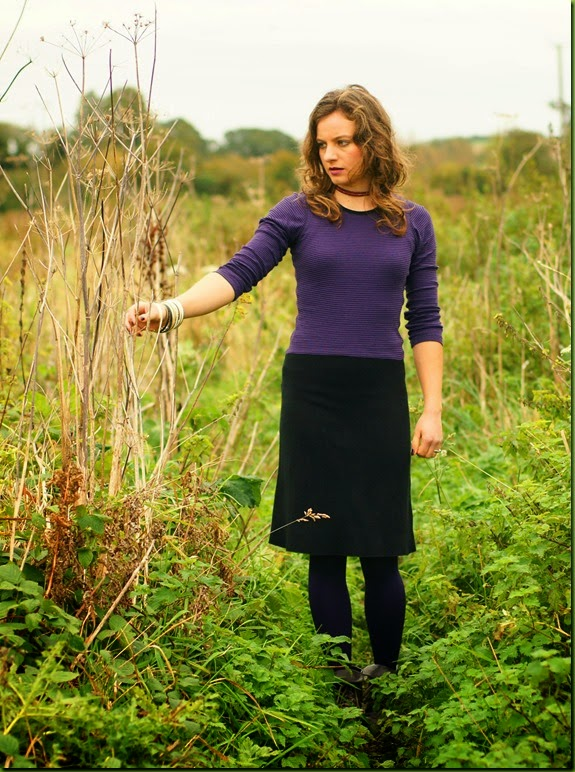 purple bodycon dress in a field