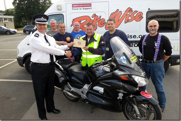DCC Michael Banks presenting cheque from BikeWise to Paul Carter