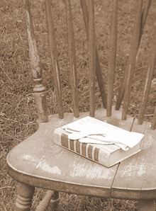 chair with book and glove