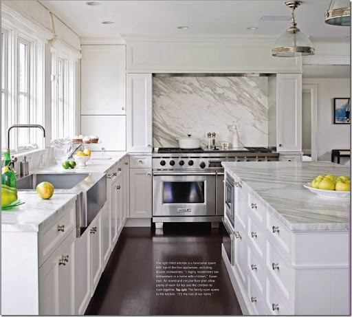 awesome White Kitchen Cabinets With White Marble Countertops #2: What a great idea u2013 behind the range - instead of tiles, install a large  piece of marble. This really shows off the distinctive veining.