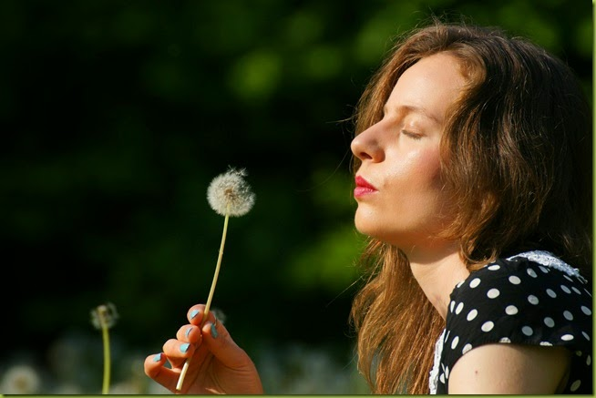 making a wish with dandelions