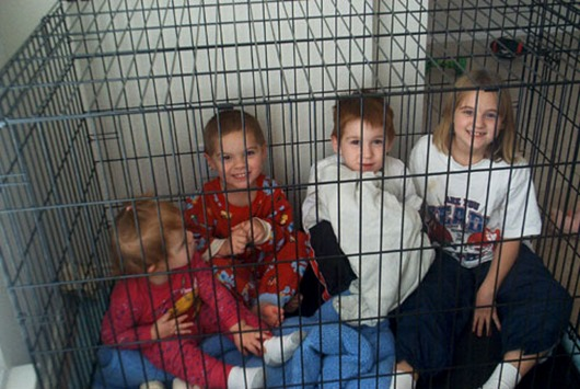 four-kids-in-dog-cage