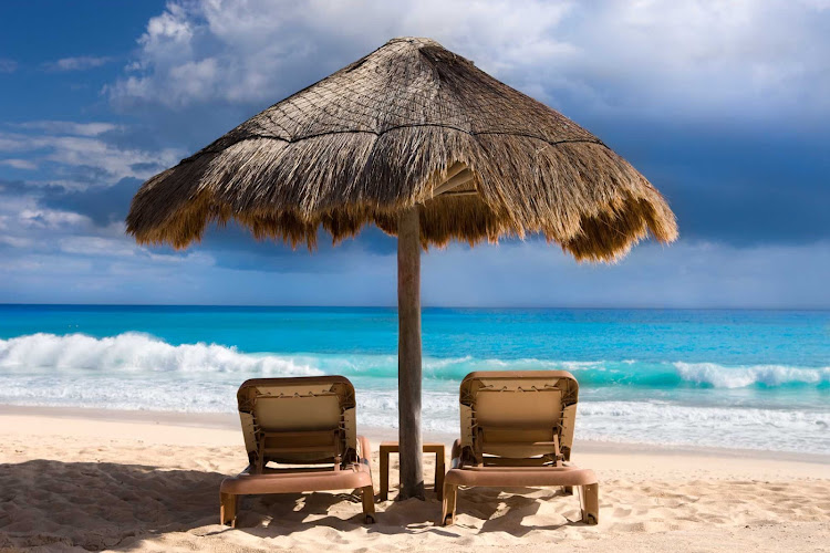 Get recharged by relaxing along a gorgeous beach in Cancun, Mexico.
