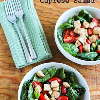 Baby Kale Caprese-Style Salad with Fresh Mozzarella, Tomatoes, and Basil.