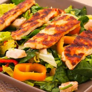 Grilled Halloumi Salad with Rotisserie Chicken, Mini Peppers, and Lemon.