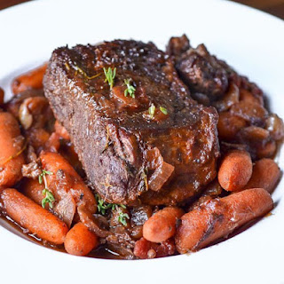 Individual Pot Roasts with Thyme-Glazed Carrots.