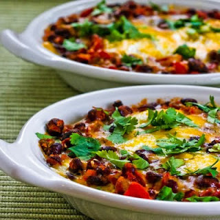 Mexican Baked Eggs with Black Beans, Tomatoes, Green Chiles, and Cilantro.