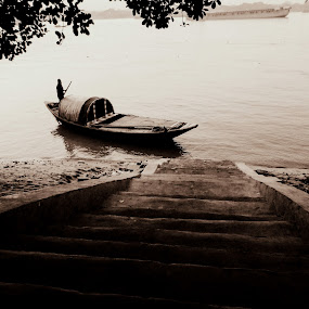 Awaiting ride by Caesar Jees - Transportation Boats ( water, monochrome, kolkata, boats, boat, people, river )