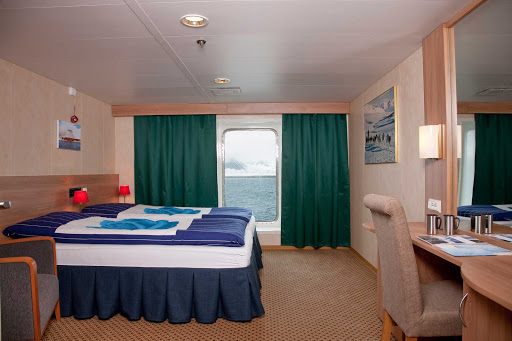 Arctic-Expedition-Category-4-Cabin-Stateroom - The Cabin 4 Stateroom aboard Expedition from G Adventures has two twin beds that convert to a king-size bed and a large window for watching the passing landscapes.