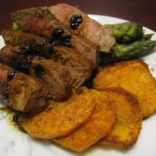 Peppered Sweet Potato Rounds with Marinated Tenderloin and Asparagus.