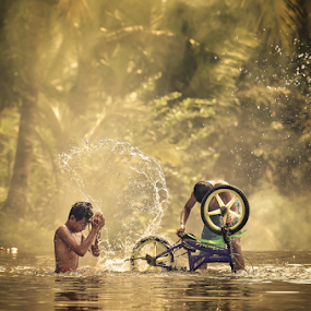 Bike Washing by Anton Subiyanto - Babies & Children Children Candids ( water, bike, candids, street, human interest, children, game, people, conceptual )