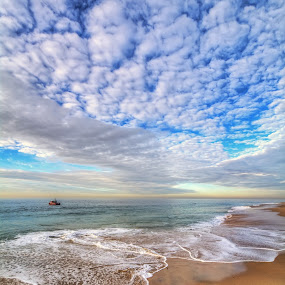Ocean Touches The Sky by Eddie Yerkish - Landscapes Waterscapes ( marine, water, shore, sand, waterscape, waves, touches, wedge, ocean, newport, seascape, beach, landscape, sky, life, nature, shoreline, surf, nikon, rocks )