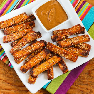 Baked Sesame Tofu Sticks with Peanut Butter, Tahini, and Ginger Sauce.