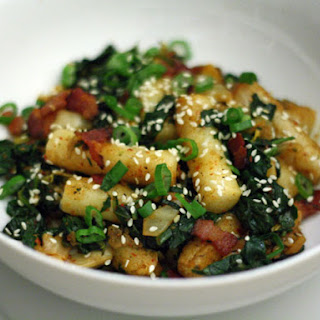 Rice Cakes with Kimchi, Bacon, and Spinach.