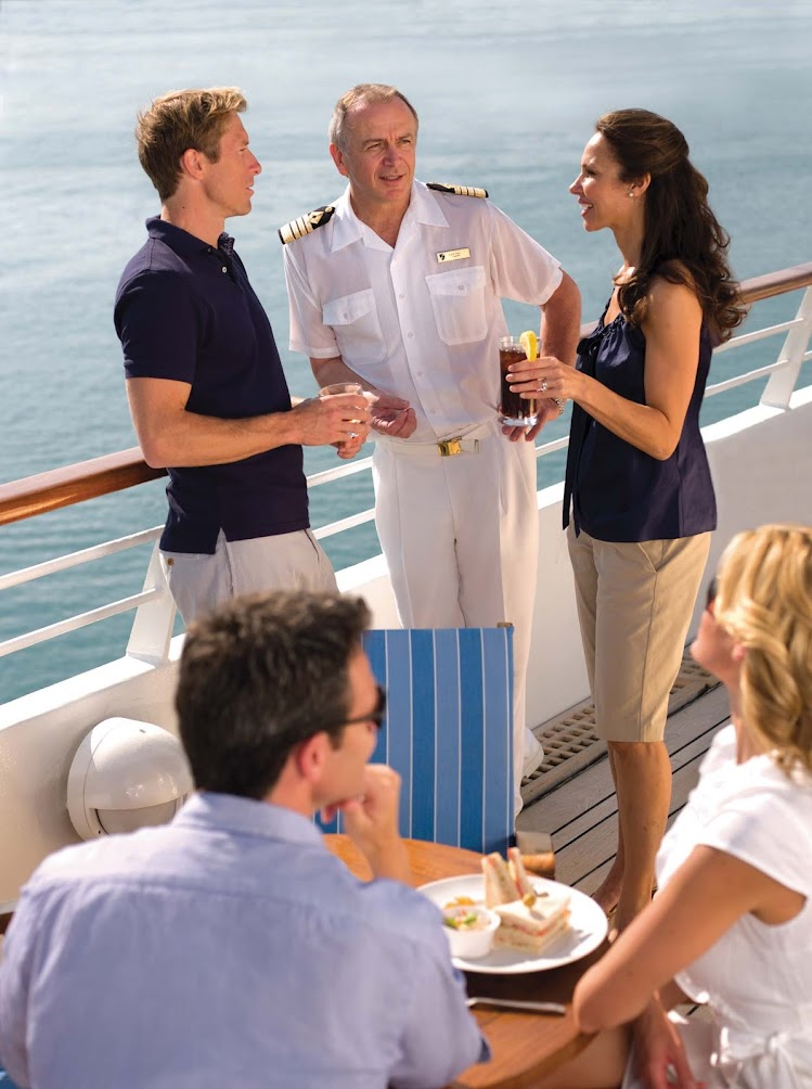 Catch the Seabourn ship captain interacting with guests over at the Sky Bar, a place for fun conversations, great views and cool drinks.