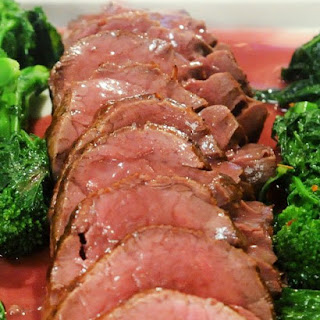 Whole Roasted Beef Tenderloin with Red-Wine Butter Sauce.