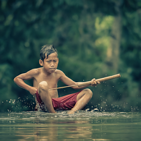 The Game by Anton Subiyanto - Babies & Children Children Candids ( water, child, indonesia, human interest, children, streets, candid, conceptual, people )