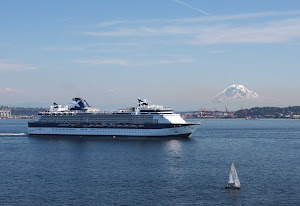 Celebrity Infinity sails out of Seattle Harbor with Mt. Rainier in the background.