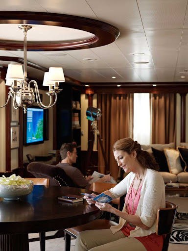 The living room in the Oceania Suite aboard Oceania Riviera is designed with comfort and quietude in mind.