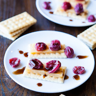 Roasted Grapes and Balsamic Reduction with Cheese and Crackers.