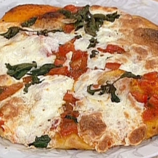 Thin Crusted Focaccia Pizza With Fresh Tomato, Basil And Mozzarella.