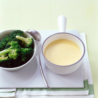 Steamed Broccoli with Cheddar Sauce.
