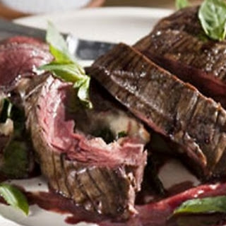 Red wine marinated flank steak filled with prosciutto, Fontina and basil with Cabernet-shallot reduction.