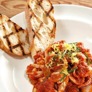 Sauteed Calamari with Tomatoes, Basil, Raisins, and Pine Nuts.