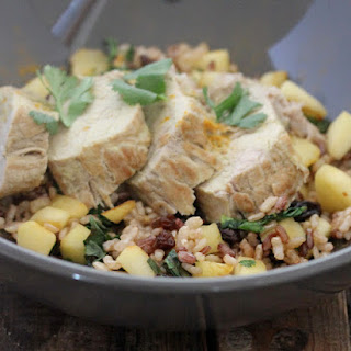 Curried Pork Tenderloin with Fried Rice with Apples and Raisins.