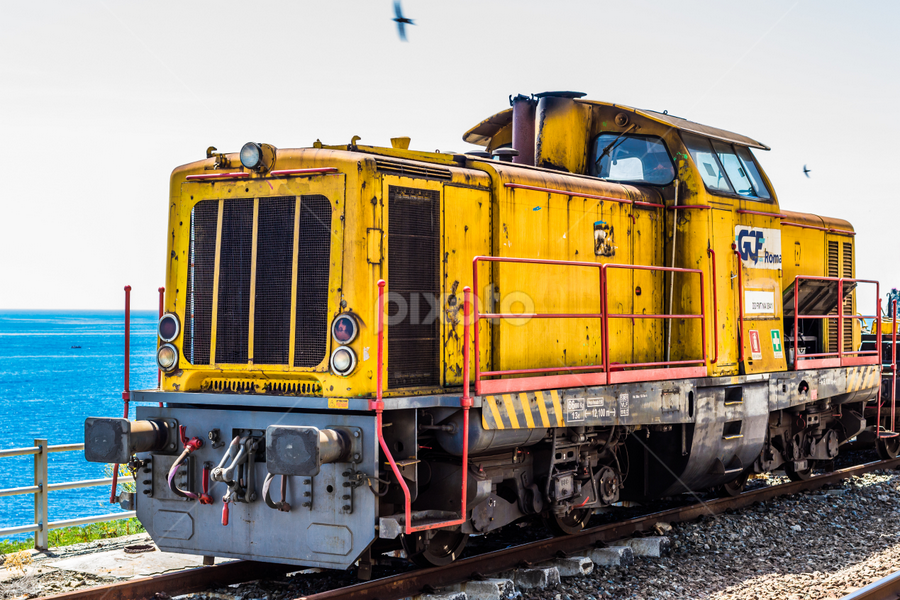A locomotive by Cesare Morganti - Transportation Trains ( station, locomotive, train, transportation, yellow )