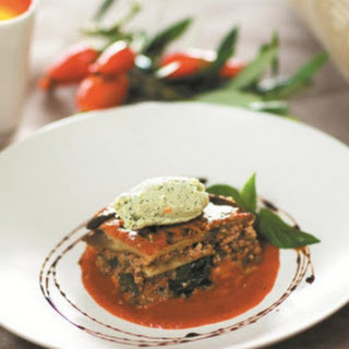 Eggplant Moussaka On Spinach With Roasted Tomato Sauce.