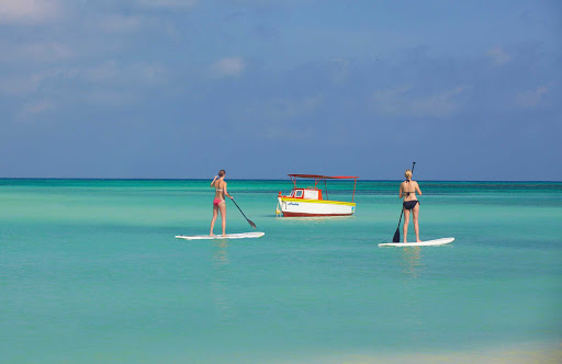 paddleboard-Aruba - Two women on stand-up paddleboards in Aruba.