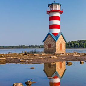 Grafton Lighthouse in Illinois by Kenneth Keifer - Buildings & Architecture Public & Historical ( flooding, shore, remember, reflection, illinois, colorful, reflected, weather vane, stone, valley, tribute, landscape, muddy, grafton, high water, nature, 1993, striped, bank, monument, rocks, water, memorial, midwest, white, lighthouse, symbolic, commemorate, united states, rural, reflecting, mississippi, landmark, midwestern, tower, faux, red, flood, great flood, trees, waterfront, river )