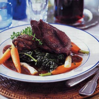Chicken in Red Wine Sauce with Root Vegetables and Wilted Greens