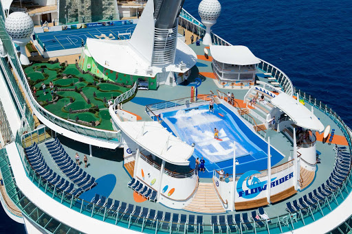 Liberty-of-the-Seas-aft - Liberty of the Seas, staffed with a crew of over 1,300, offers a wide assortment of onboard experiences, including 10 pools and whirlpools, the popular FlowRider, more than100 spa treatments and multiple  entertainment options.