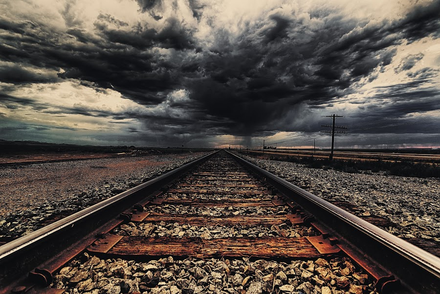 Riding the storm by Mike Ritchie - Landscapes Weather ( clouds, sky, wood, dark, train, tracks, storm, rocks, iron )