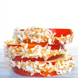 Apple Sandwiches with Peanut Butter and Shredded Coconut.