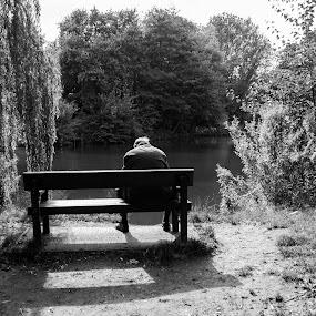 Alone by Derek Robinson - Black & White Street & Candid
