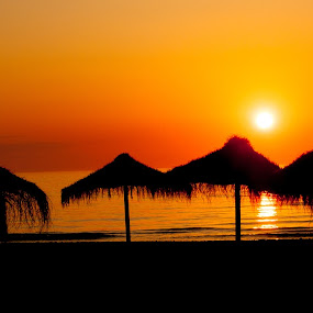 Spanish Beach by RaeLynn Petrovich - Landscapes Beaches ( grass hut, vacation, sunset, silhouette, beach, spain )