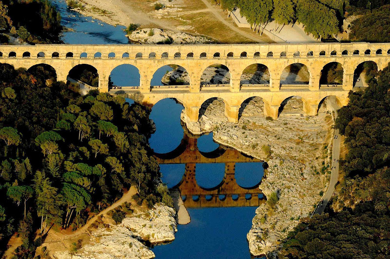 The ancient Roman aqueduct bridge, Pont du Gard, crossing the Gardon River in the Languedoc-Roussillon region of southern France.