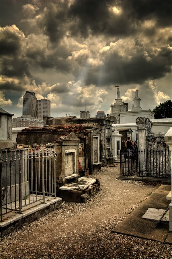 Cloudy Day at St. Louis Cemetery by Chrystal Mimbs - City,  Street & Park  Cemeteries ( clouds, new orleans, brick ovn, tomb, chrystal mimbs, black and white, graves, louisiana, blacks, crypt, historic, highlights, sun, grave sites, midtones, sky, final rest, plaster, path, walkway, city of the dead, cloudy day at st. louis cemetery, saint louis cemetery number 1, sidewalk,  )